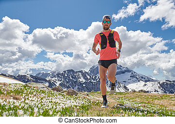 Strong Trail Running athlete in the mountains in training