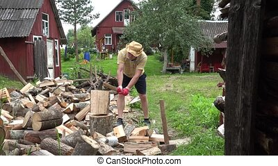 Strong villager boy prepare natural wood fuel and rural...