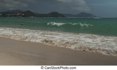 Strong waves at South China Sea on Dadonghai Beach stock...