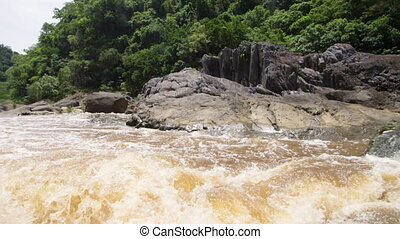 Strong waves from a muddy stream - Kayaking on a muddy river...