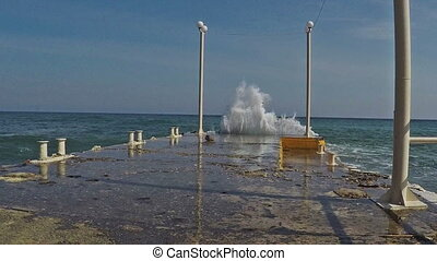 strong waves strike pier - strong waves strike the pier