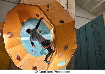 Strong-willed boulderer with physical disability keeps ...
