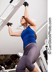 Strong woman doing bar pull ups