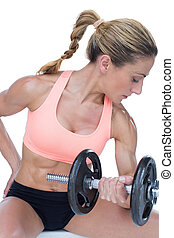 Strong woman doing bicep curl with