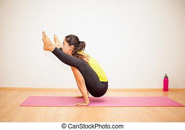 Strong woman doing some yoga