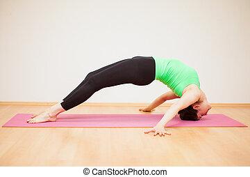 Strong woman doing yoga