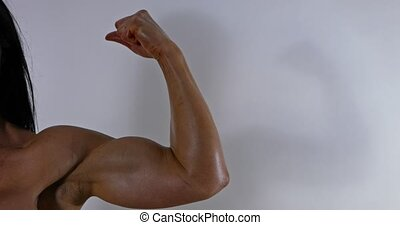 Strong woman showing her biceps
