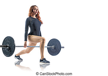 Strong young woman with beautiful athletic body doing exercises with barbell.