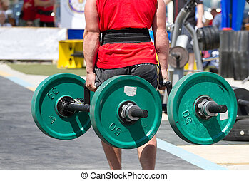 Strongmen lifting heavy barbell - Strongmen in lifting heavy...