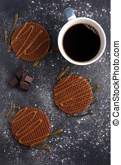 Stroopwafels with caramel sauce and coffee