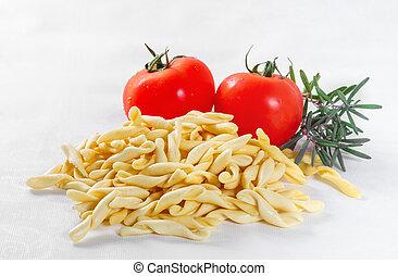 Strozzapreti with tomatoes on white background