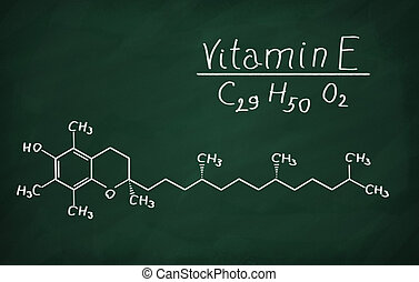 Structural model of Vitamin E (tocopherol) on the blackboard.
