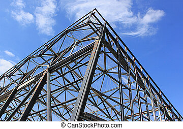 structural steel - a metal frame with safety net against a ...