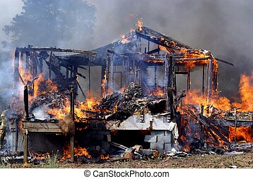 Structure Fire - The remains of a structure after being...