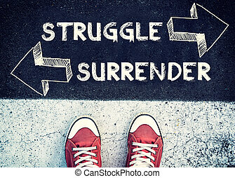 Struggle and surrender - Student standing above the sign...