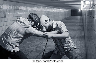 Two men in gas masks in the tunnel