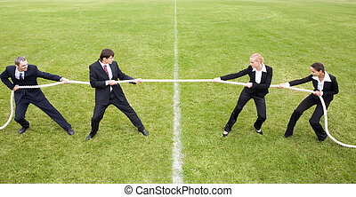 Image of white collar worker pulling the rope in the stadium