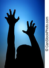 Struggle - Silhouette of Man Reach Towards The Sky. Symbolic...