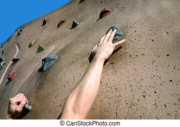 Struggle - Struggling to reach handhold on climbing wall