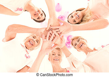 Happy women in different age with power to struggle with cancer
