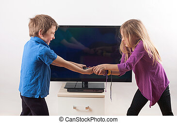 Struggling for the remote control - Siblings fighting over...