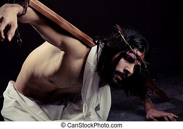 Struggling Jesus Christ for Easter with the cross on his...