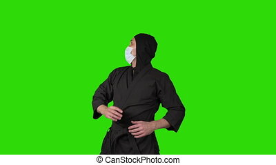 Video of man in black costume ninja on green isolated background