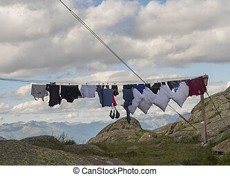 Stubai Valley, Innsbruck-Land, Tyrol, Austria, July 5, 2020: washed clothes at washing line, clothesline at Bremer Hutte with view of moutain peaks