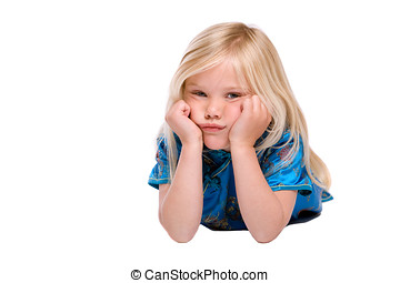 Stubborn and bored - Cute four year old girl lying on the...
