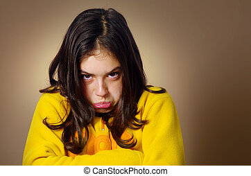 Stubborn Girl - Spoiled young girl with pouty expression and...