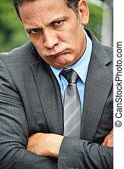 Stubborn Handsome Business Executive