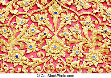 stucco design of native thai style on the Wall
