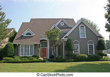 Stucco House 2 - Nice stucco house on green lawn against...