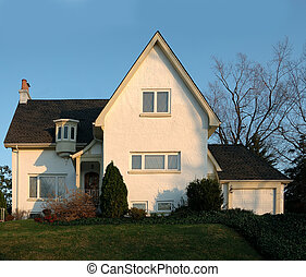 Stucco House in America - A two story white stucco house.