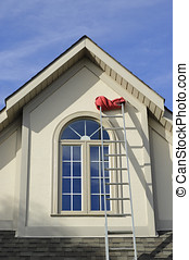 Stucco house window and extension ladder - Extension ladder...