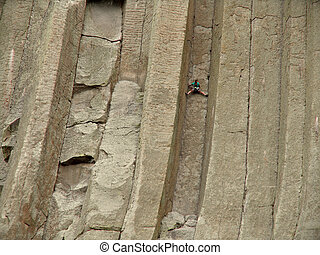 stuck - climbing devils tower - a climber scaling devils...
