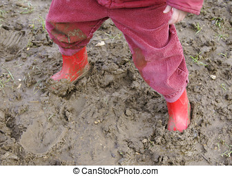 stuck in mud  - child\\\'s wellington boots in mud