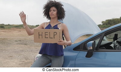 Stuck in the deset African American model with help sign -...