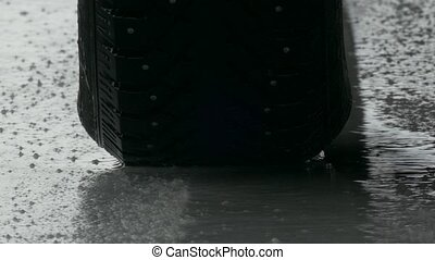 Studded tyre driving on ice - Studded car winter tyre...