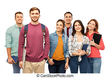 studenci, uśmiechanie się, książki, grupa