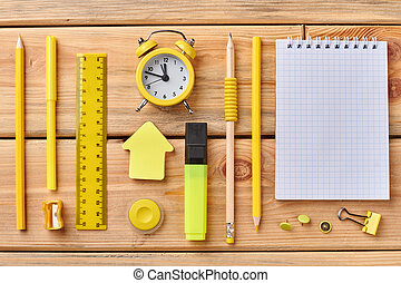 Student accessories on wooden background.