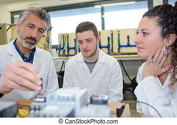 student and teacher in biology training course