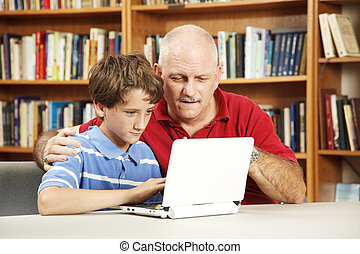Student and Teacher on Computer