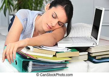 Student asleep next to work