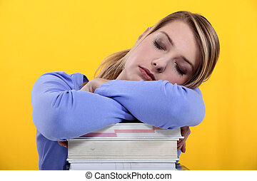 Student asleep on her books
