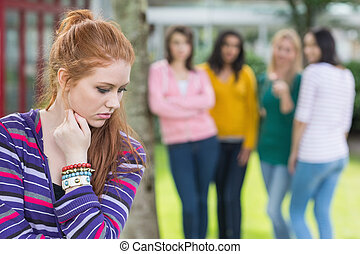 Student being bullied by a group of students