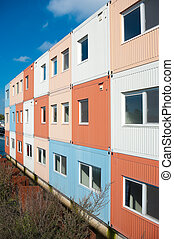 student boat - colorful cargo containers used for housing ...