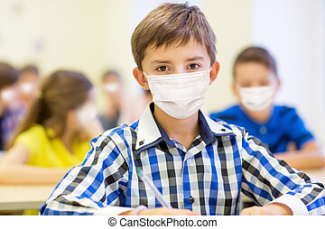 student boy in protective medical mask at school - education...