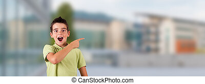 student boy with expression of surprise or admiration at school