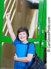 Student Celebrating Victory Against Door In School